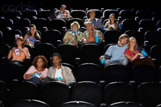 People Watching Movie in Movie Theater